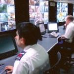 guards monitoring screens